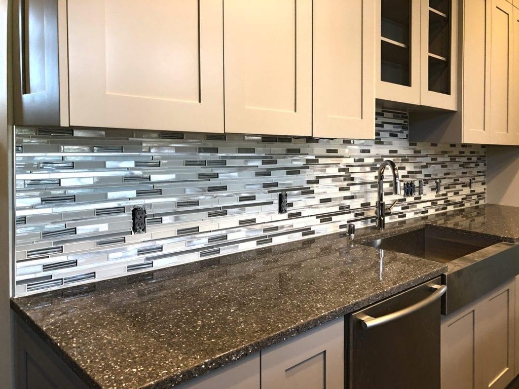 Modern glass tile backsplash by Artistic Home Finishes