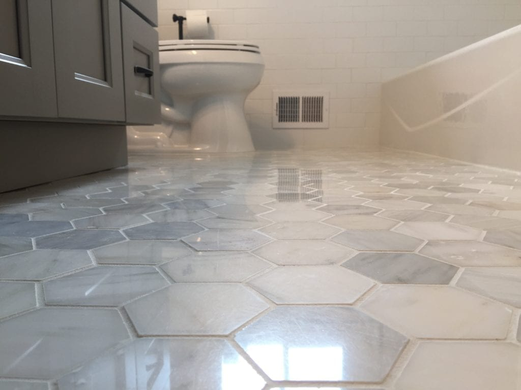 Ceramic tile bathroom floor by Artistic Home Finishes