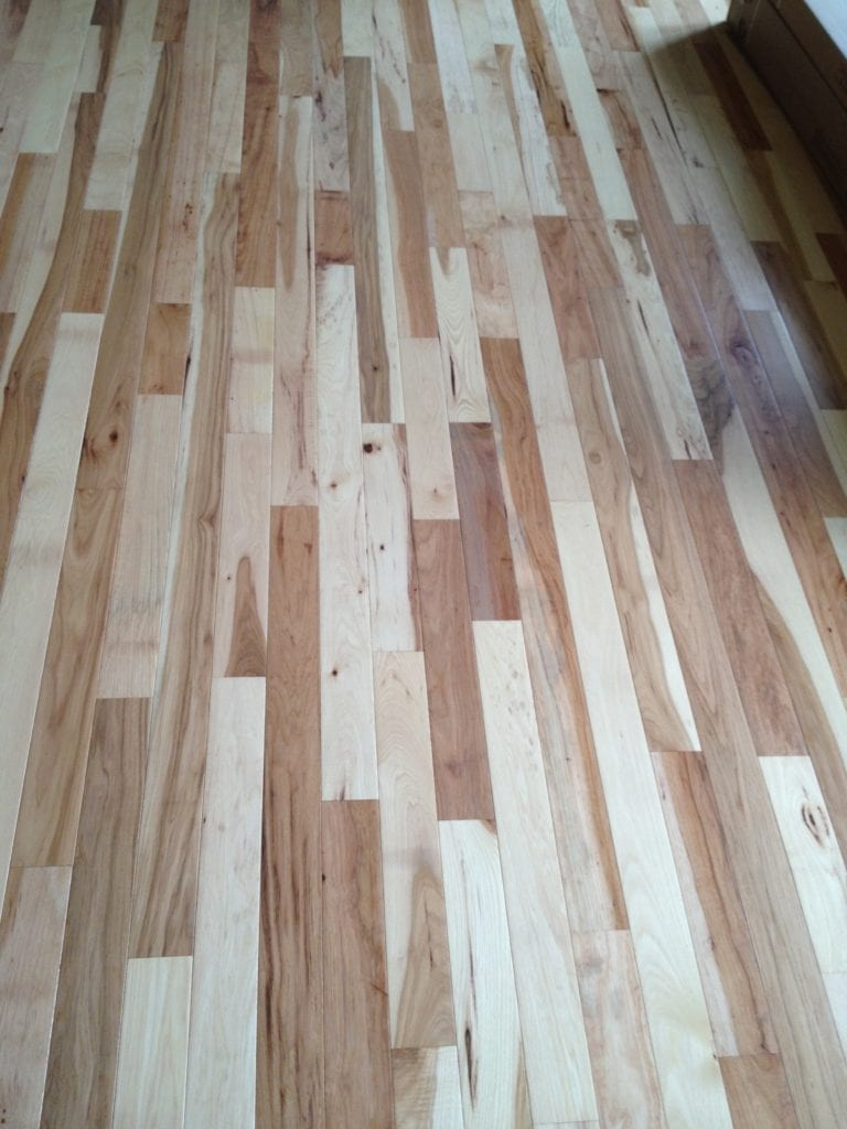 Natural wood flooring by Artistic Home Finishes.