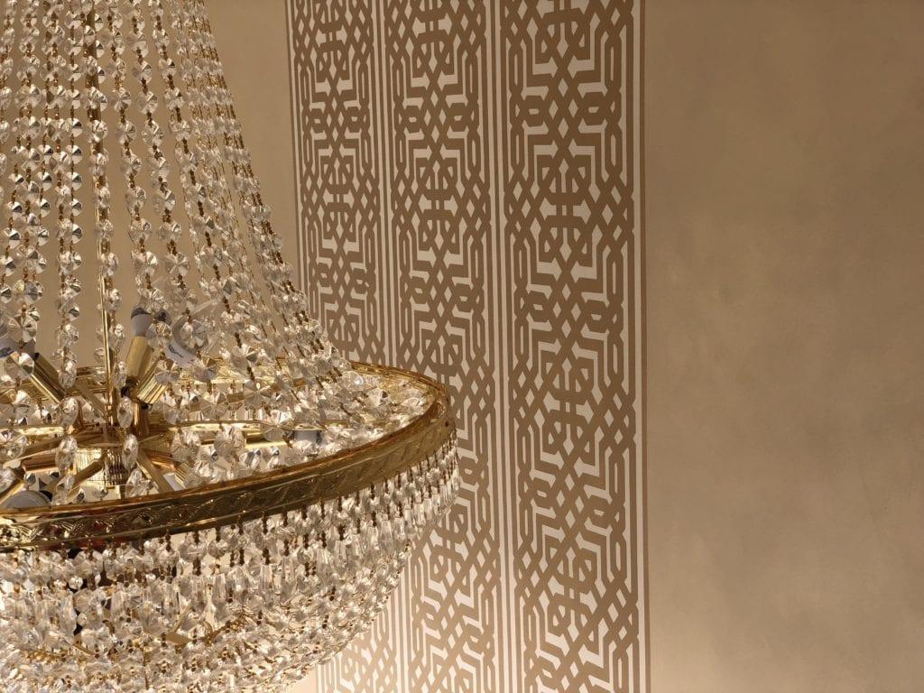 Elegant wallpaper and chandelier